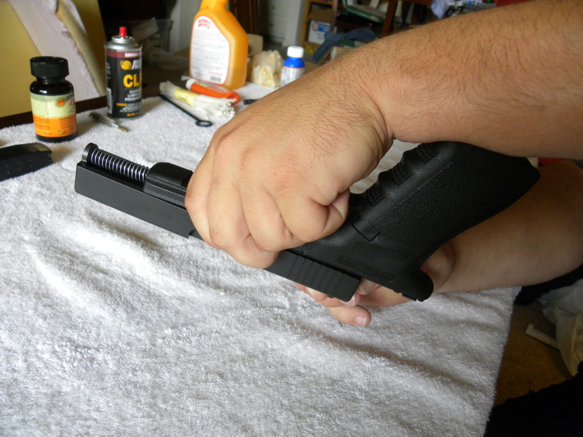 While holding the sliding pin in place, use your other hand to move the slide towards the muzzle end, and then off of the frame itself.