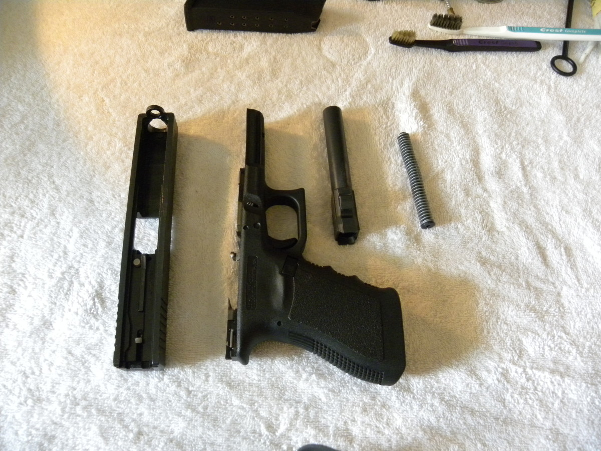 Once the slide is separated from the frame, remove the guide rod and spring, as well as the barrel, and set them aside. Your Glock should now be stripped for cleaning.