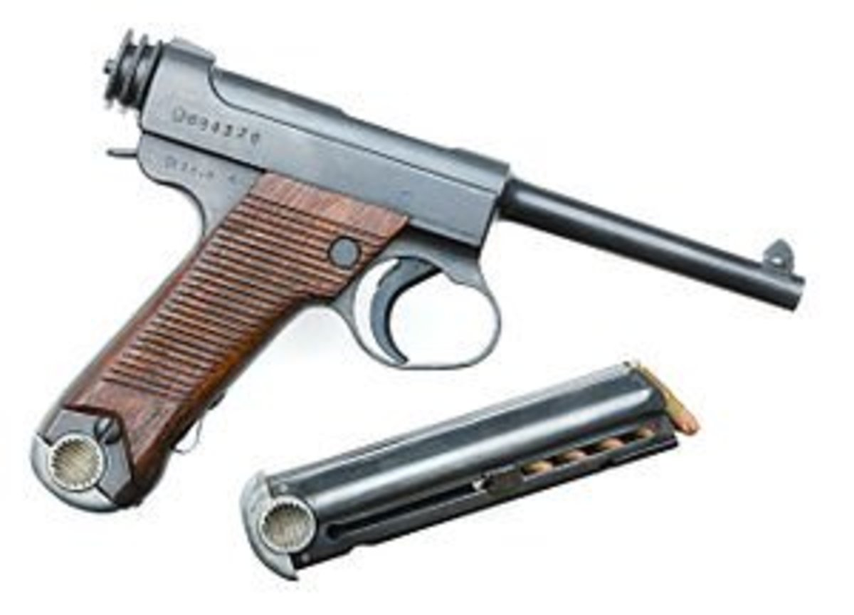 The Nambu Pistol that inspired the Ruger Standard, the Mark II's papa. So in a way, this Nambu pistol is the Mark II's Grandfather. (I guess that makes the Luger it's great grandfather!)