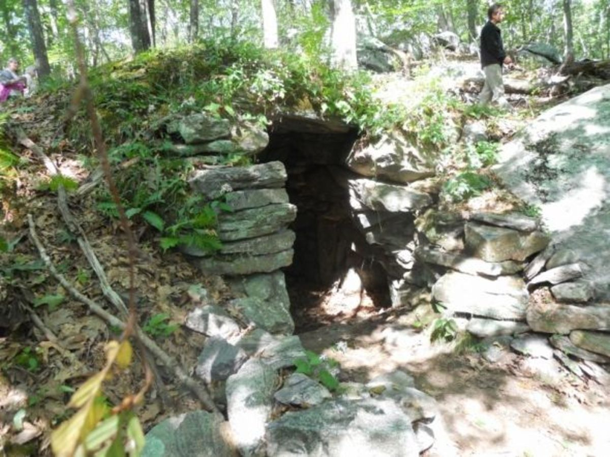 This rock structure is under a mound of dirt. If you look to the right of the entrance you can see another little side chamber.