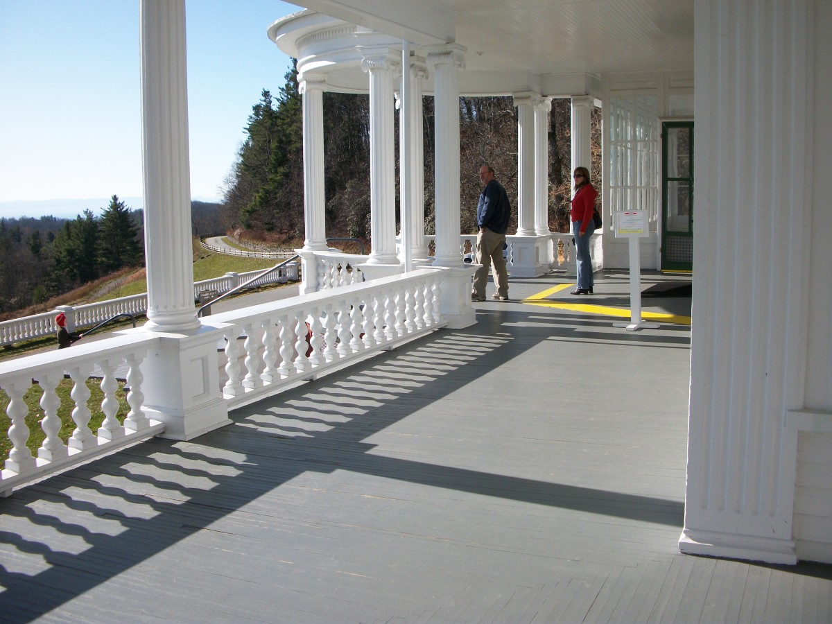 A photo of the wide porch of Flat Top Manor.