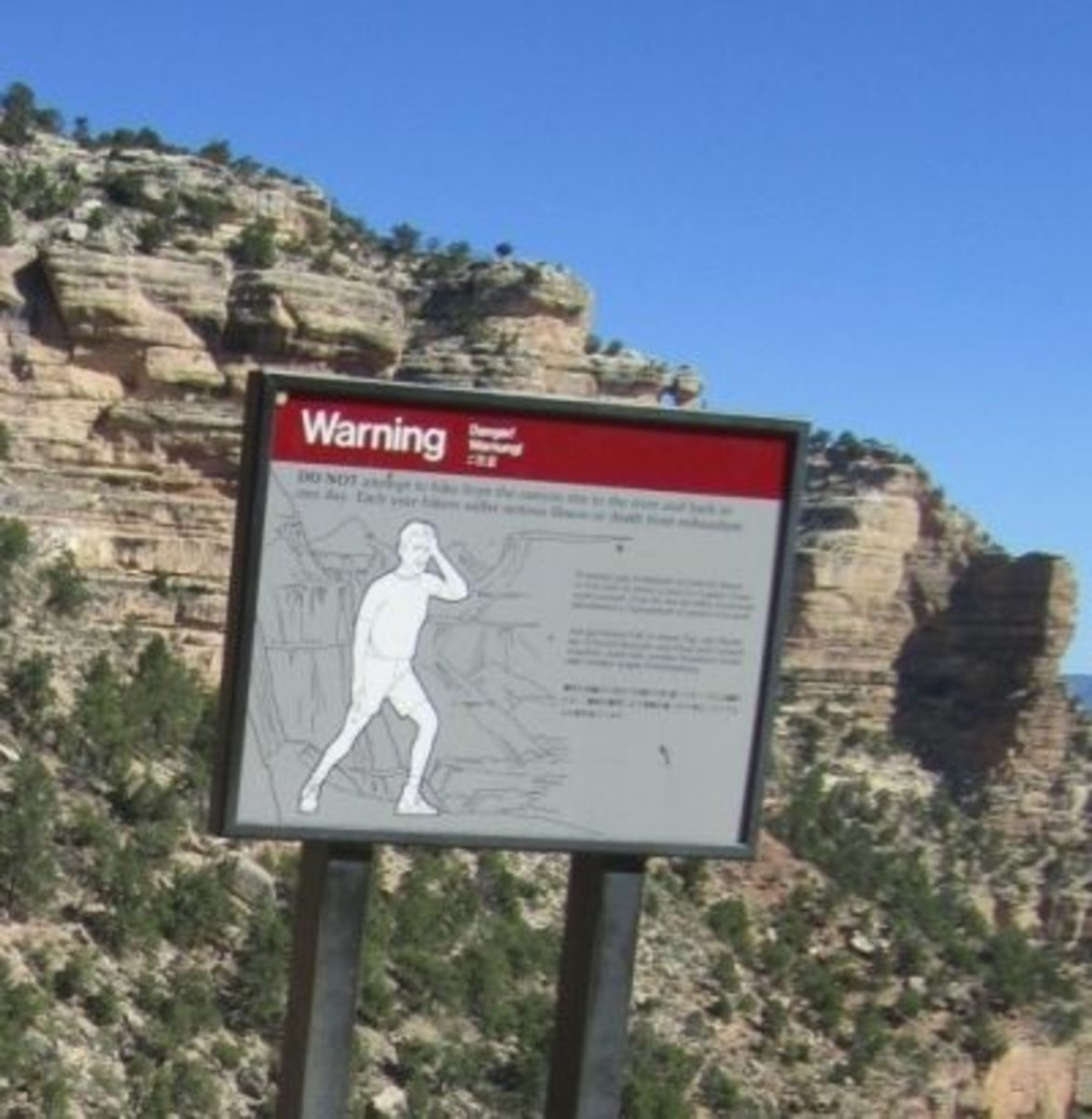 One of the warning signs posted at Grand Canyon trailheads