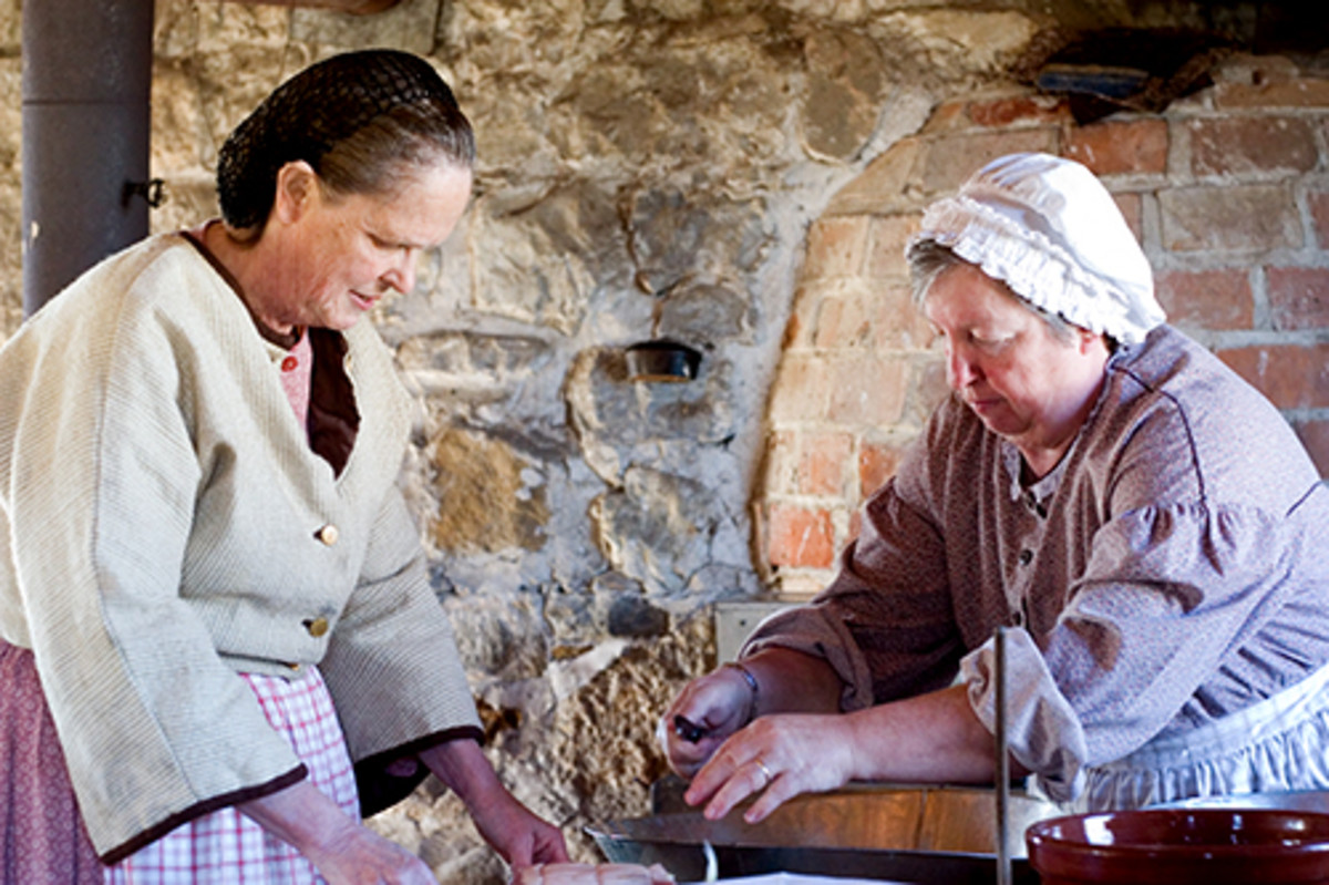 Costumed interpreters making bread as they did in the 1800s, at Upper Canada Village.