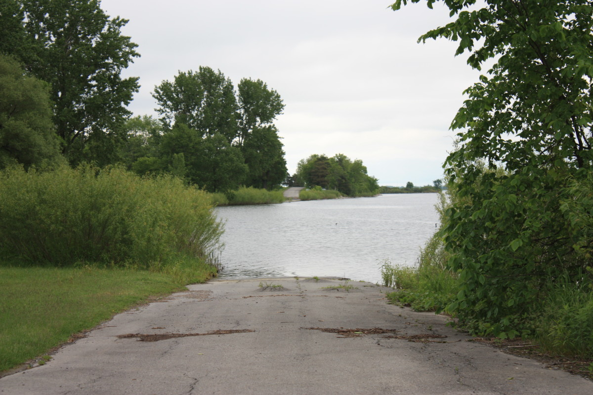 Standing at the edge of the old Highway 2.. Which is now almost completely under water, save for a few spots within the parkway where you can still see it vanish into the St. Lawrence.