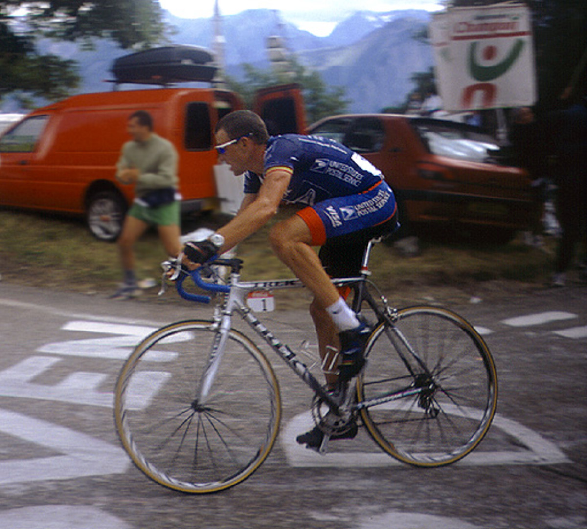Lance Armstrong riding to victory at L'Alpe d'Huez, during stage 10 of the 2001 Tour de France in his US Postal team kit