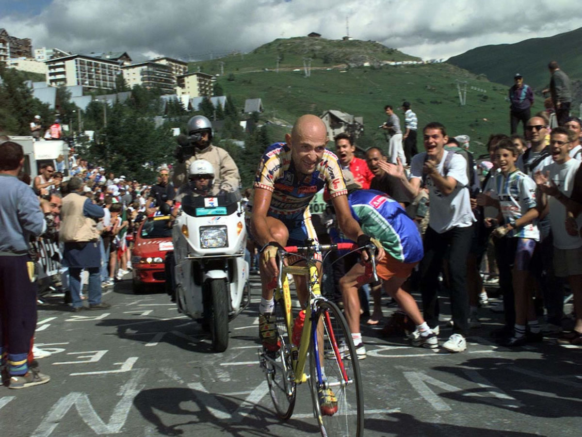 Marco Pantani climbing alone on Alp D'Huez in the 1997 Tour De France for the Mercatone Uno team.