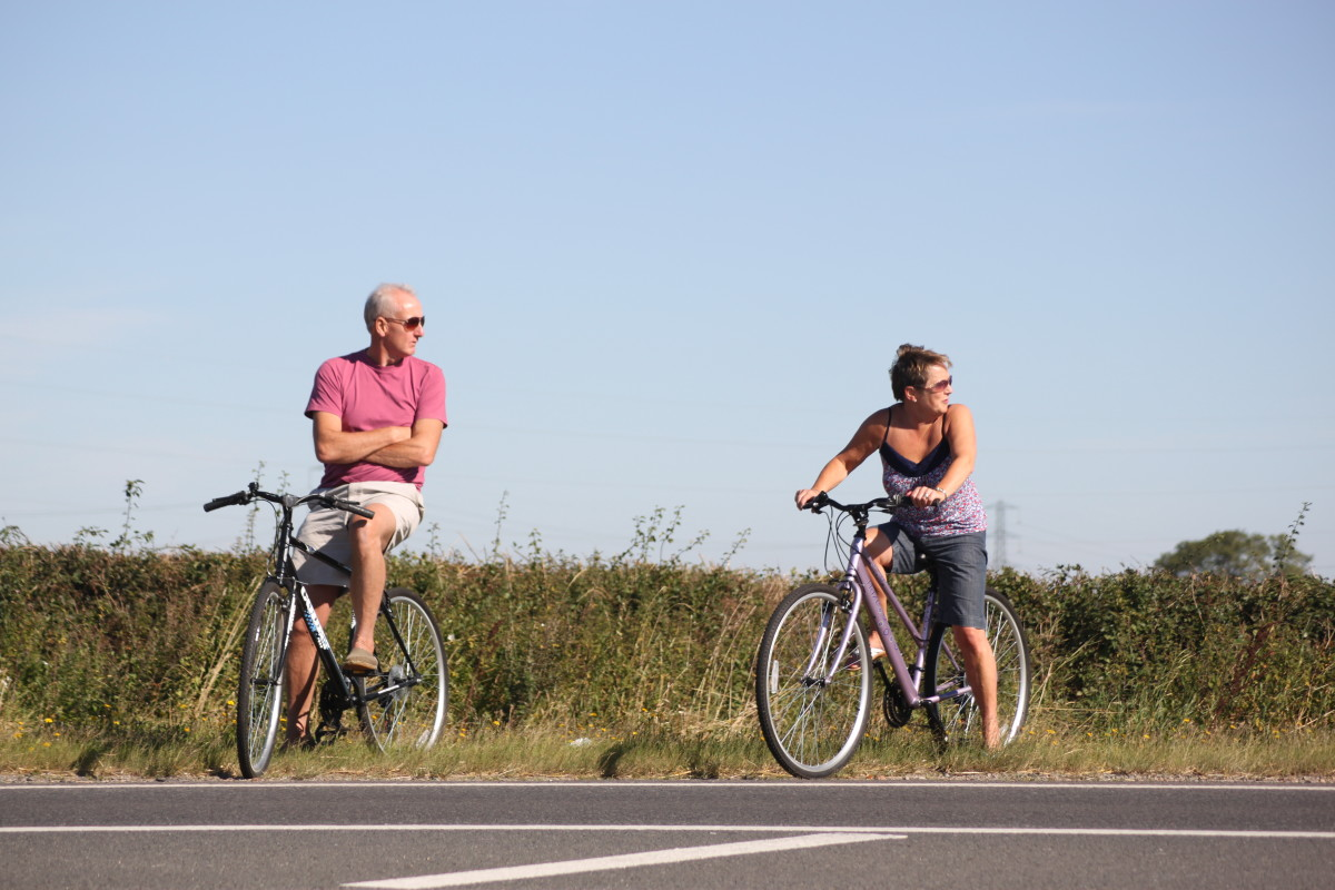 Summer is a great time to ride your bike and you shouldn't worry a gentle ride will build huge thighs. It will have a far better effect on your health.