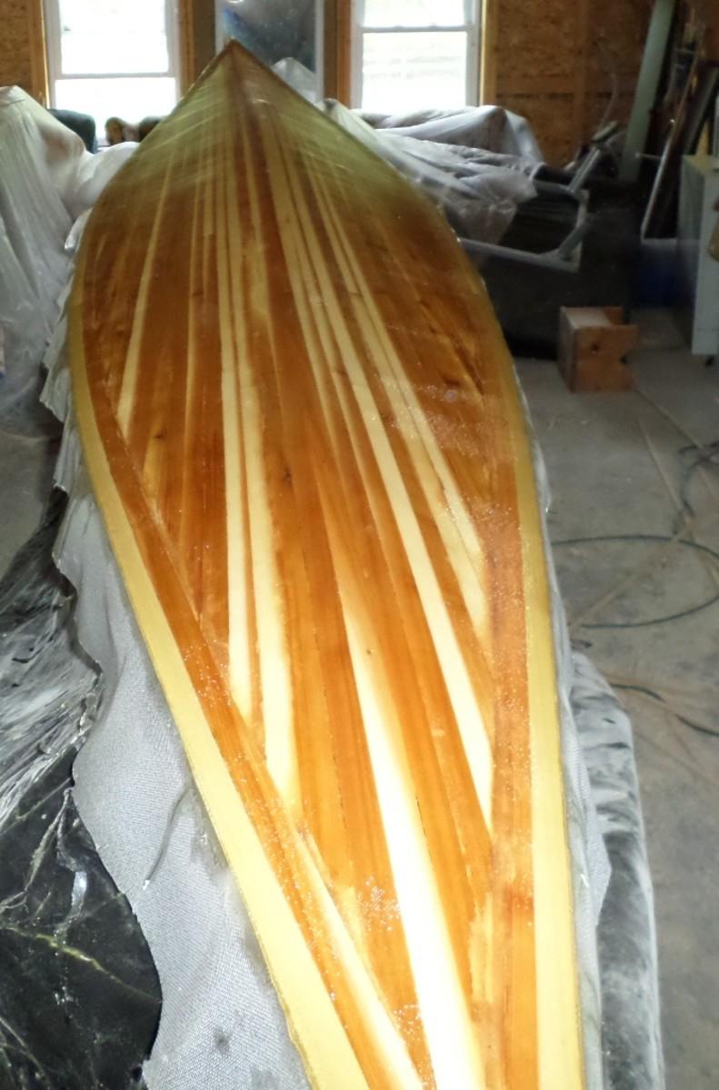 building-a-cedar-strip-kayak-the-details-exterior-fiberglass-and-planking-the-deck
