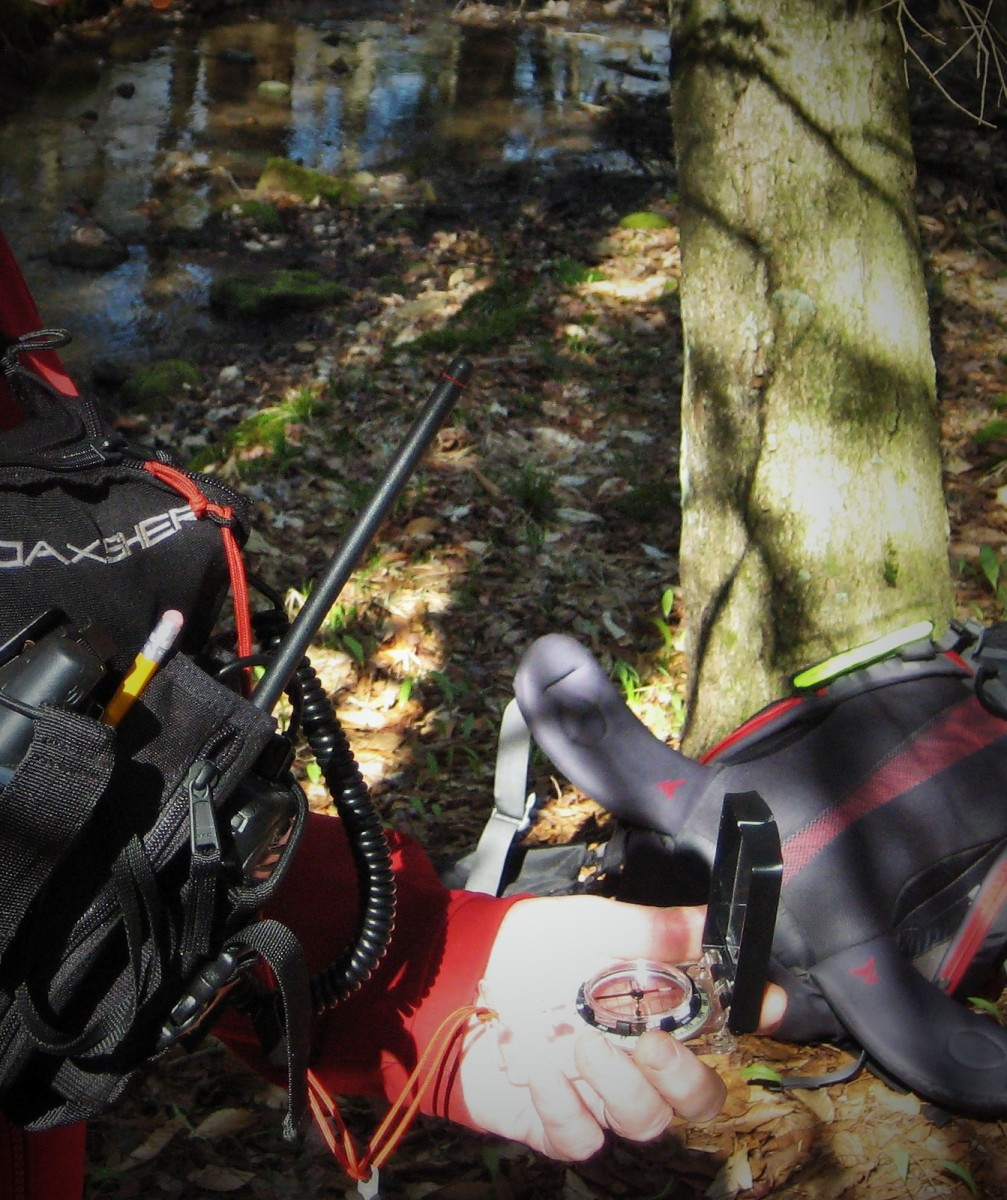 Navigating by compass on a search and rescue orienteering course.