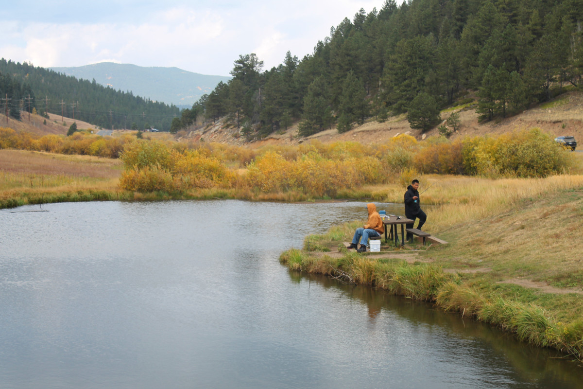Fellows fishing at Slough Pond near the trail head for Beaver Trail at Golden Gate Canyon State Park.
