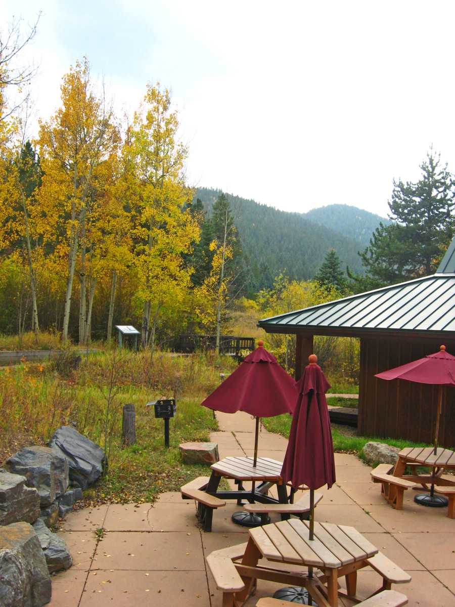 This picnic area at Golden Gate Canyon State Park features umbrellas and a grill.