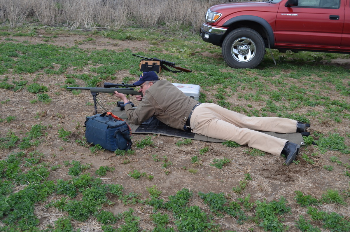 Aiming at a distant jackrabbit, the Harris bipod on this .223 bolt action rifle is an asset.