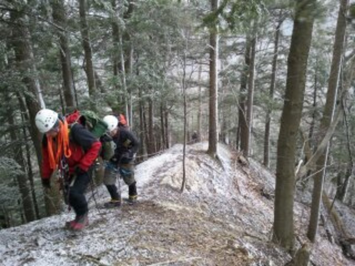 SAR members climb up out of a steep traverse at Zoar Valley.