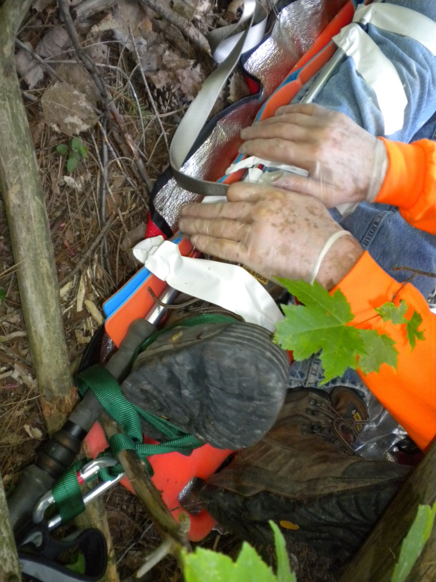 Wilderness first aid relies on skills and improvisation.  In this picture, a trekking pole is used to form a traction splint.