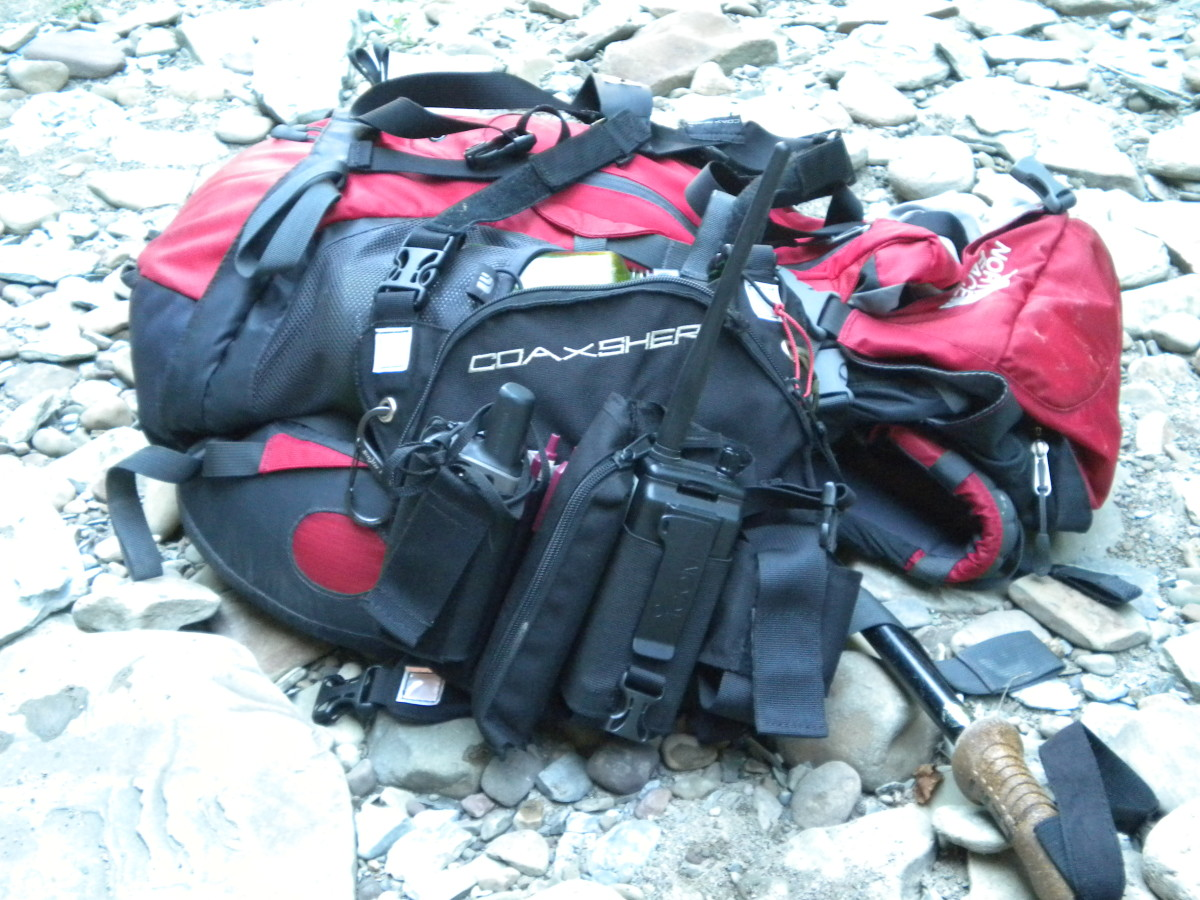 The North Face Terra 35 is a nice size for a SAR 24-hour pack.  The Coaxsher radio harness is a necessity.