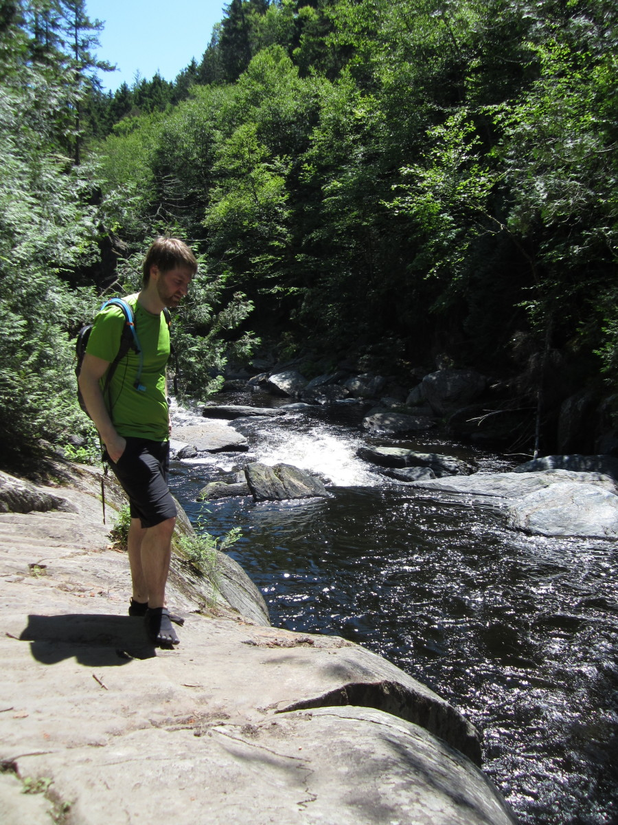 My son, Steve, on the shore of the West Branch of the Pleasant River.  Check out the Five Fingers hiking shoes.