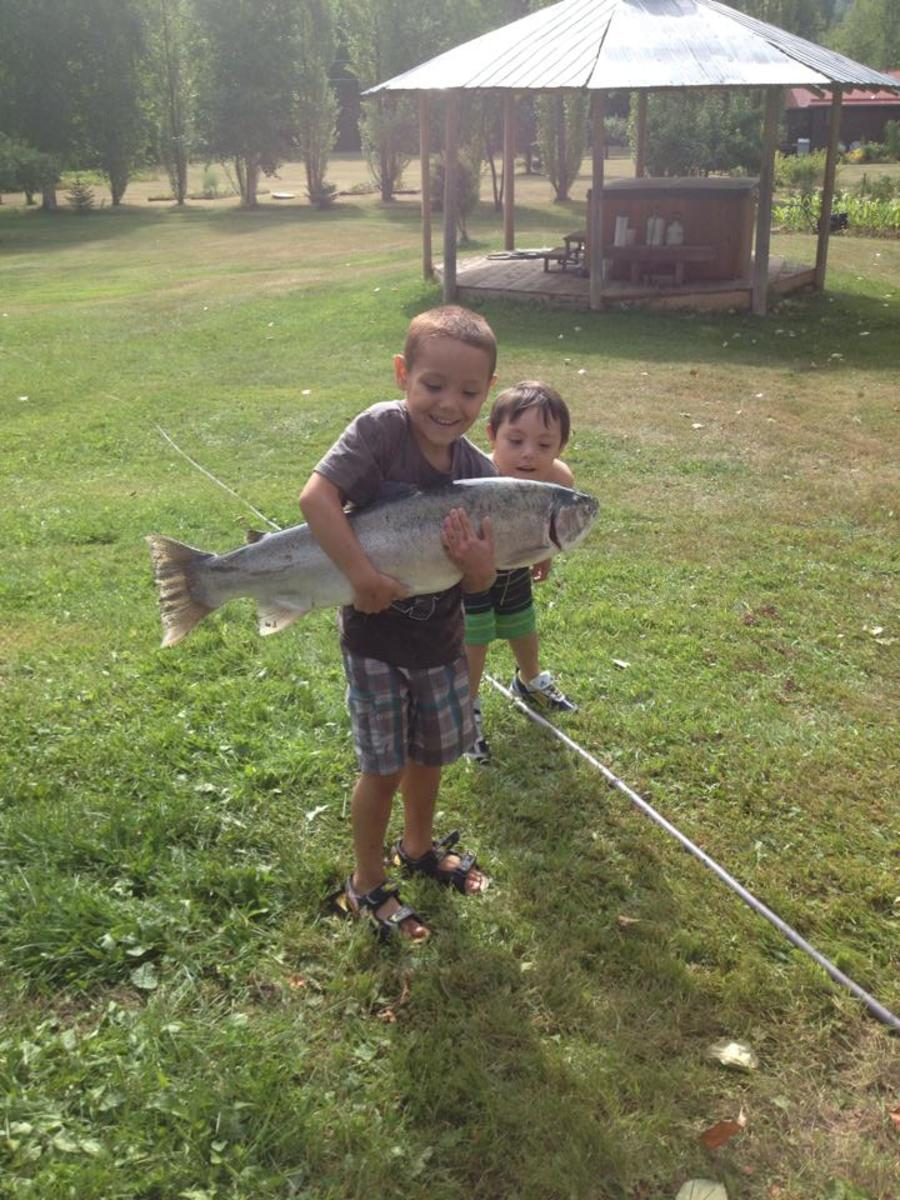 The boys playing with a steelhead we caught in the gill net.
