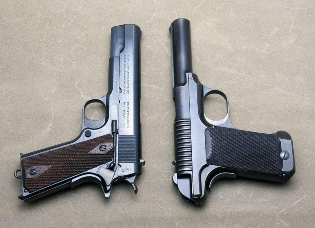 Savage 1906 model trials pistol next to a 1911