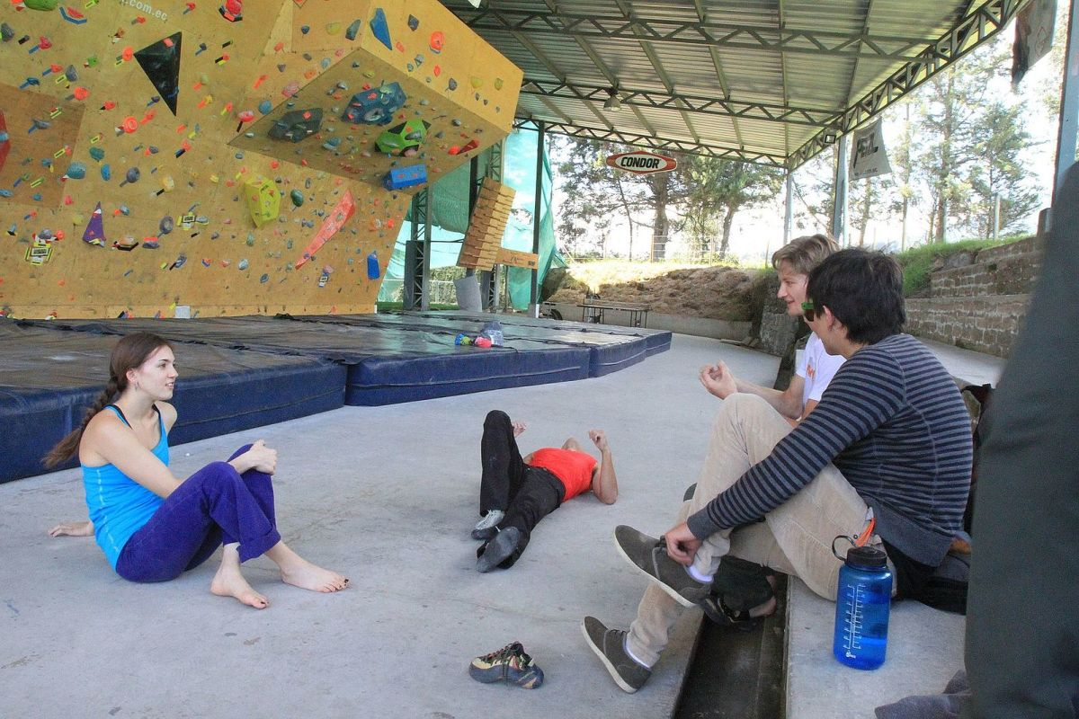 Some climbers taking a break. That's a bouldering wall in the background.