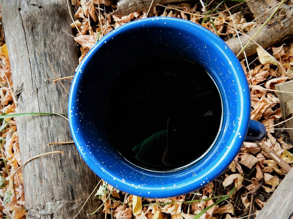Cowboy coffee in an enamelware mug.