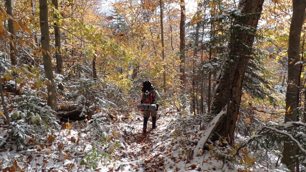 Snow over golden leaves on this Adirondack fall backpacking trip.