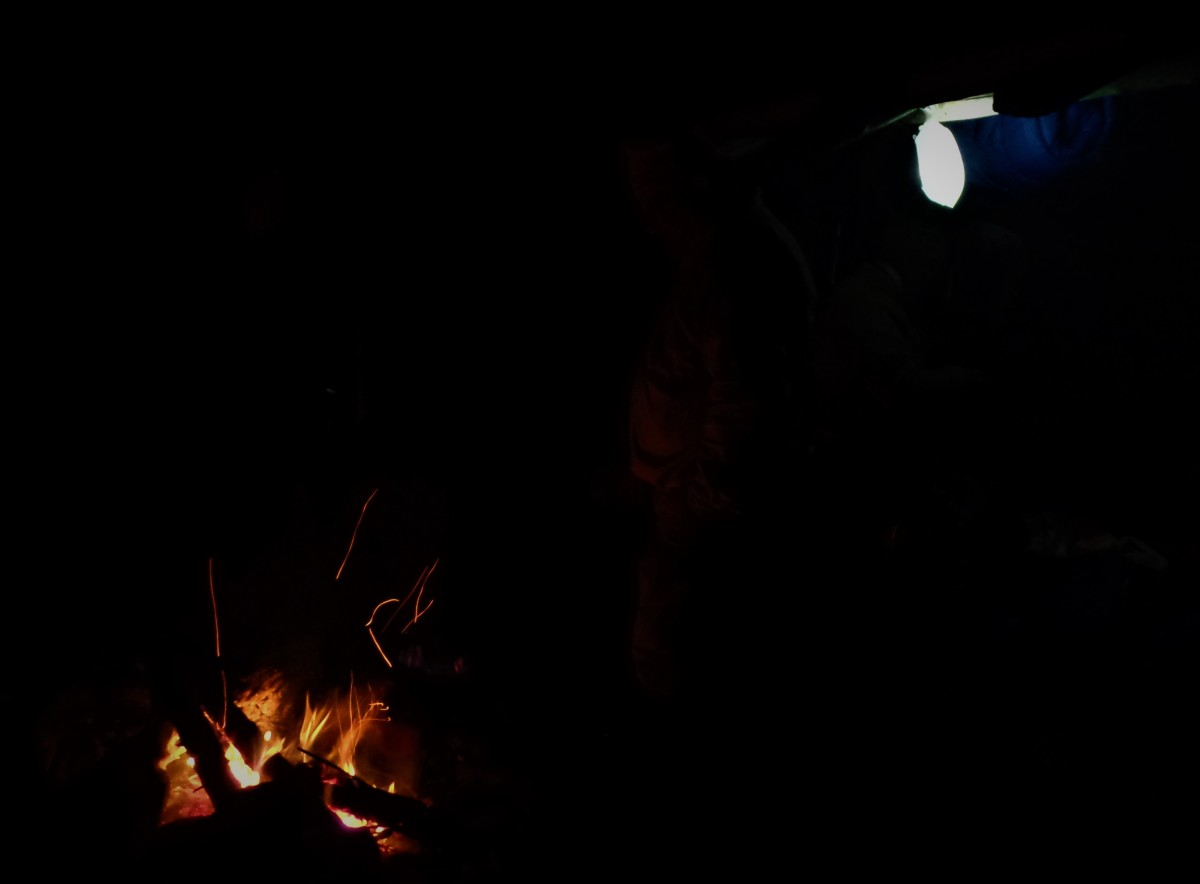 A cheery campfire and an early night on a fall backpacking trip.