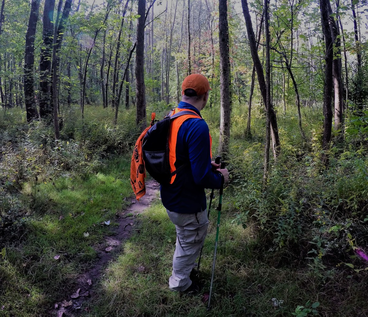 Keep safe while hiking during hunting season by wearing blaze orange.