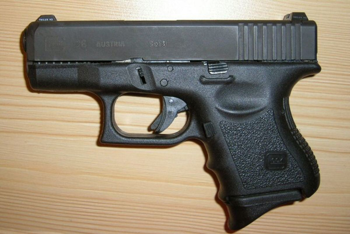 In the author's opinion, the Glock 26 9mm is perhaps the best all-round hunter back up gun.   Same size and weight as a steel frame snub-nose revolver; holds eleven rounds; reliable; and corrosion resistant.