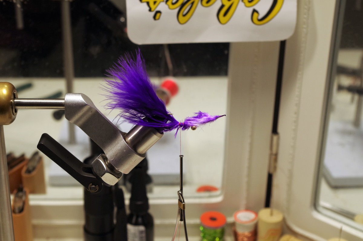 Place the Marabou Plume on the hook shank just past the midpoint. Secure with thread wraps