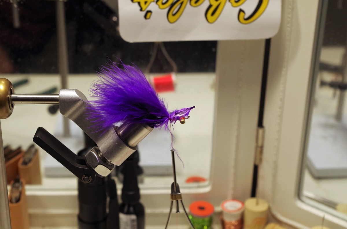 Place Marabou Plume #2 at the midpoint of the hook shank and secure with thread wraps