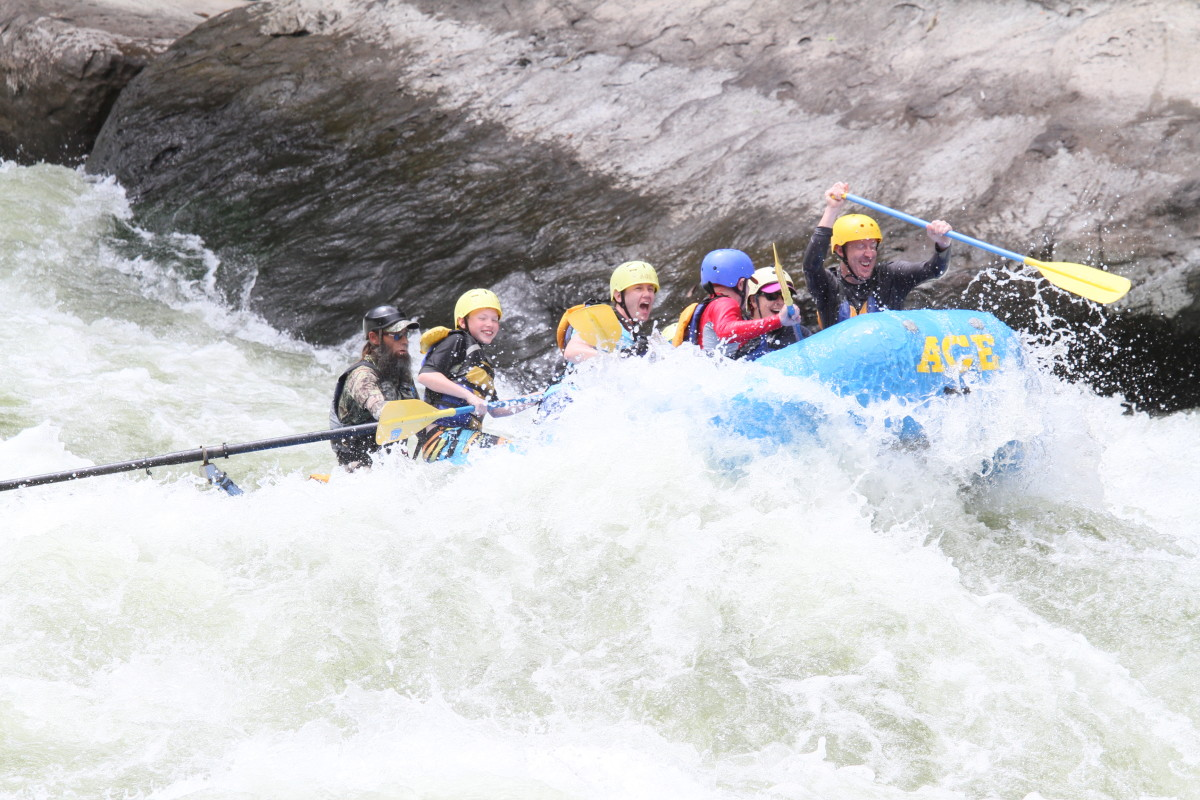 Oars and an expert guide stabilize a raft in Class V white water, allowing kids as young as 9 years of age to experience the thrill of this extreme sport.
