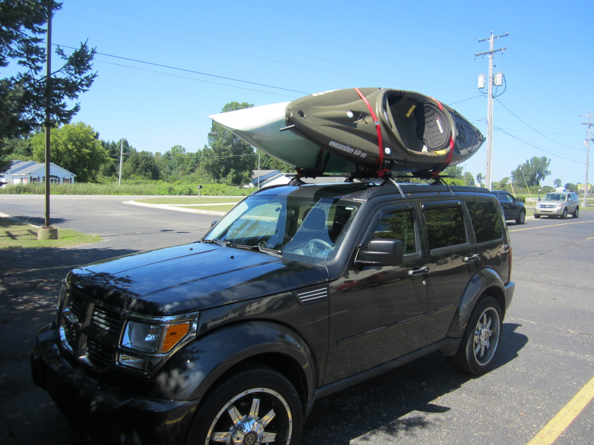 Tightly secured, the kayaks should not rattle or move freely beneath the tie-down straps.