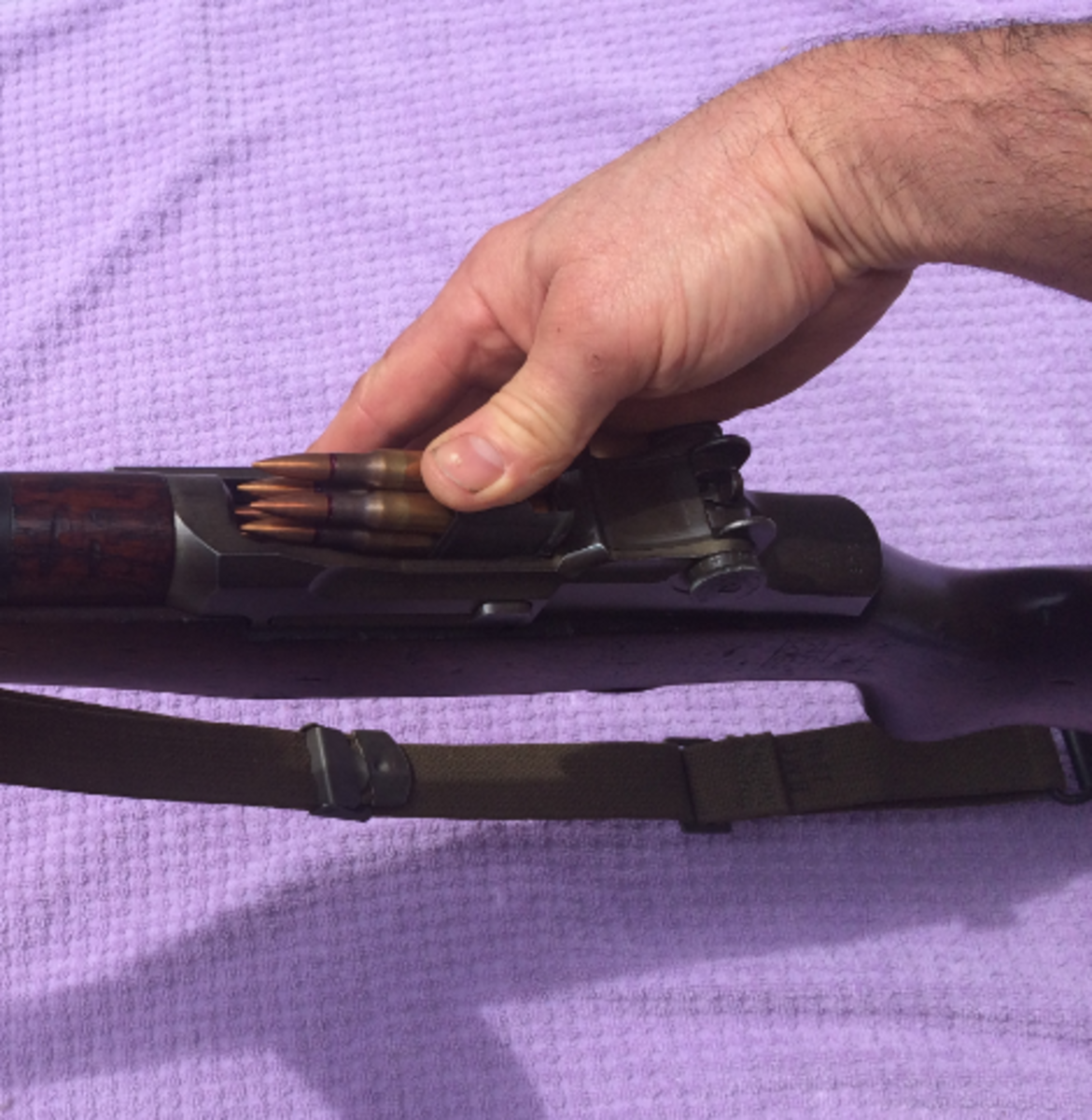 The M1's 8-round internal magazine is reloaded fast with en-block clips.