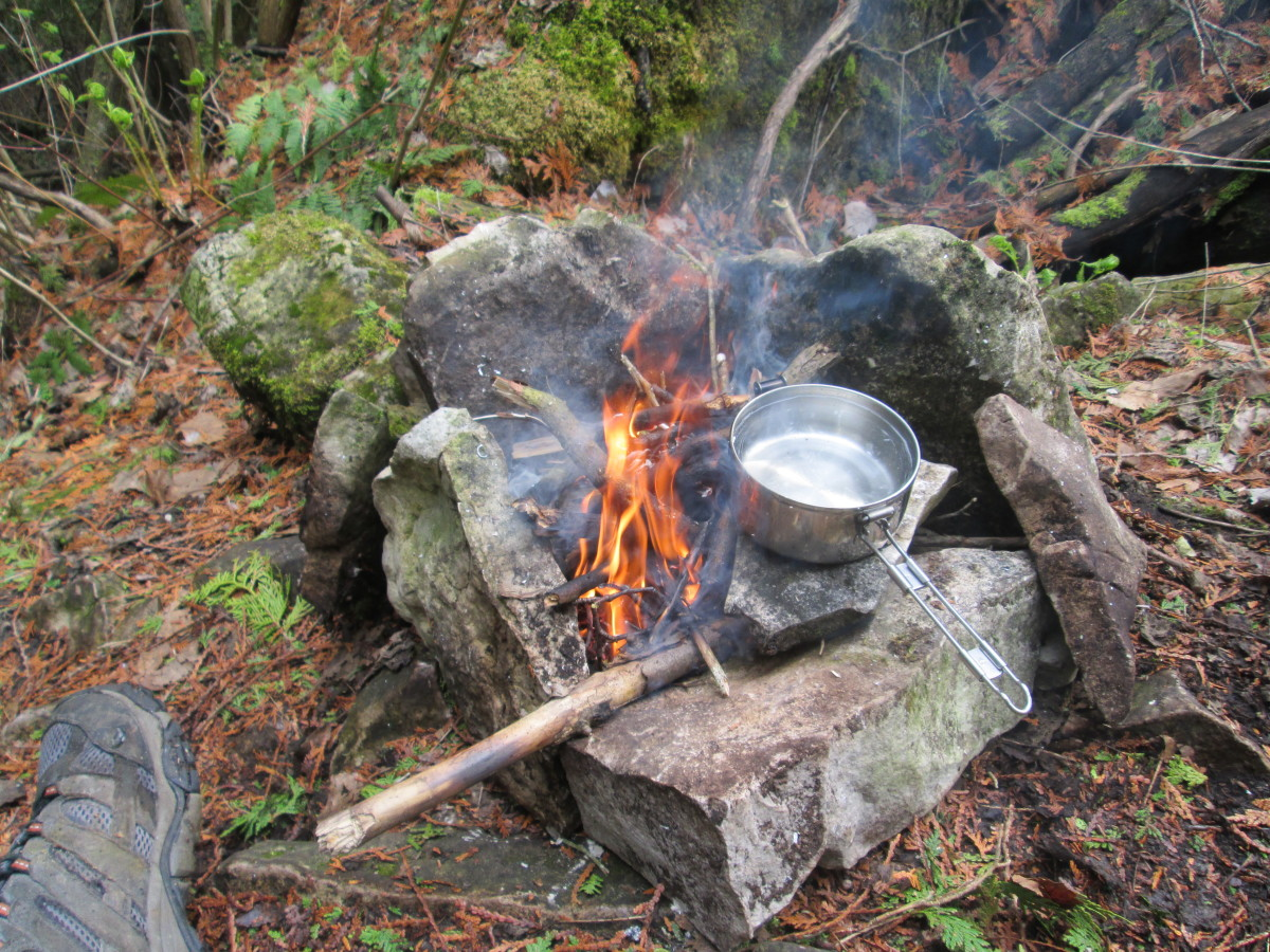 Boiling some water for tea and food. Lunch-time in the forest.