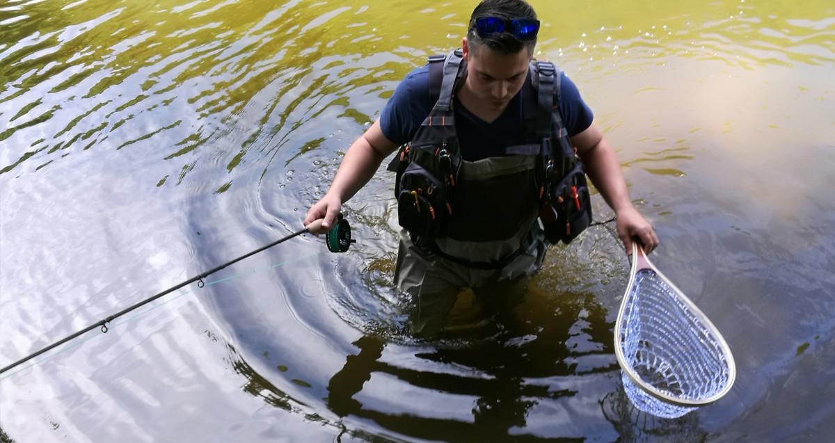 Man wearing fly fishing gear.