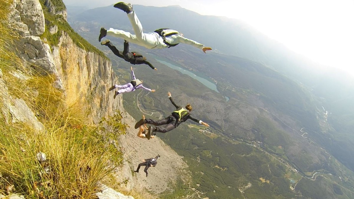 Five jumpers exiting Monte Brento, in Italy. This is a famous spot to start high jump BASE.