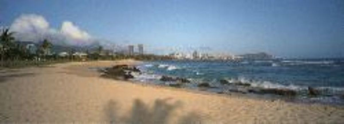 Sand Island State Recreation Area, available for camping with a view of Honolulu, HI, in the background