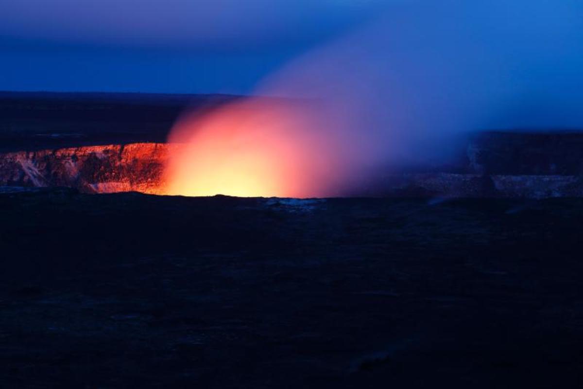 Lava glow in 2018 as evening falls on Halema'uma'u, the inner crater of Kilauea, Hawai'i Volcanoes National Park, Island of Hawai'i, HI