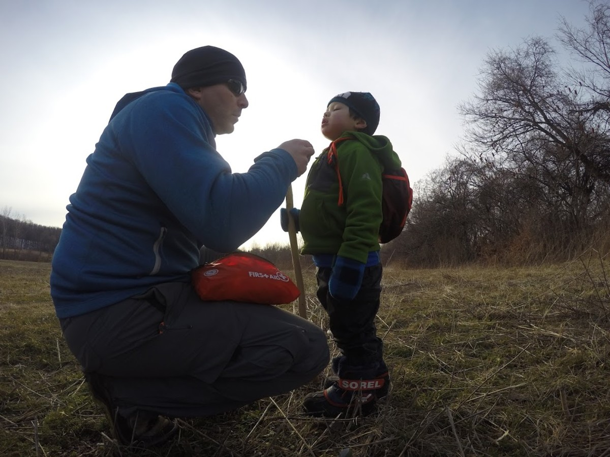 First aid for a scraped chin while hiking.