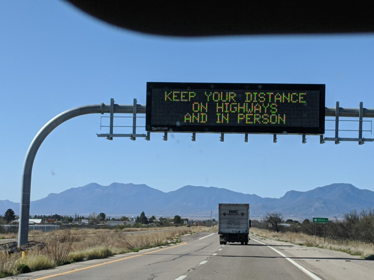 Information Alert Sign on Interstate-10 Alerting drivers to keep safe driving distance to avoid accidents and safe distance from people to avoid COVID-19