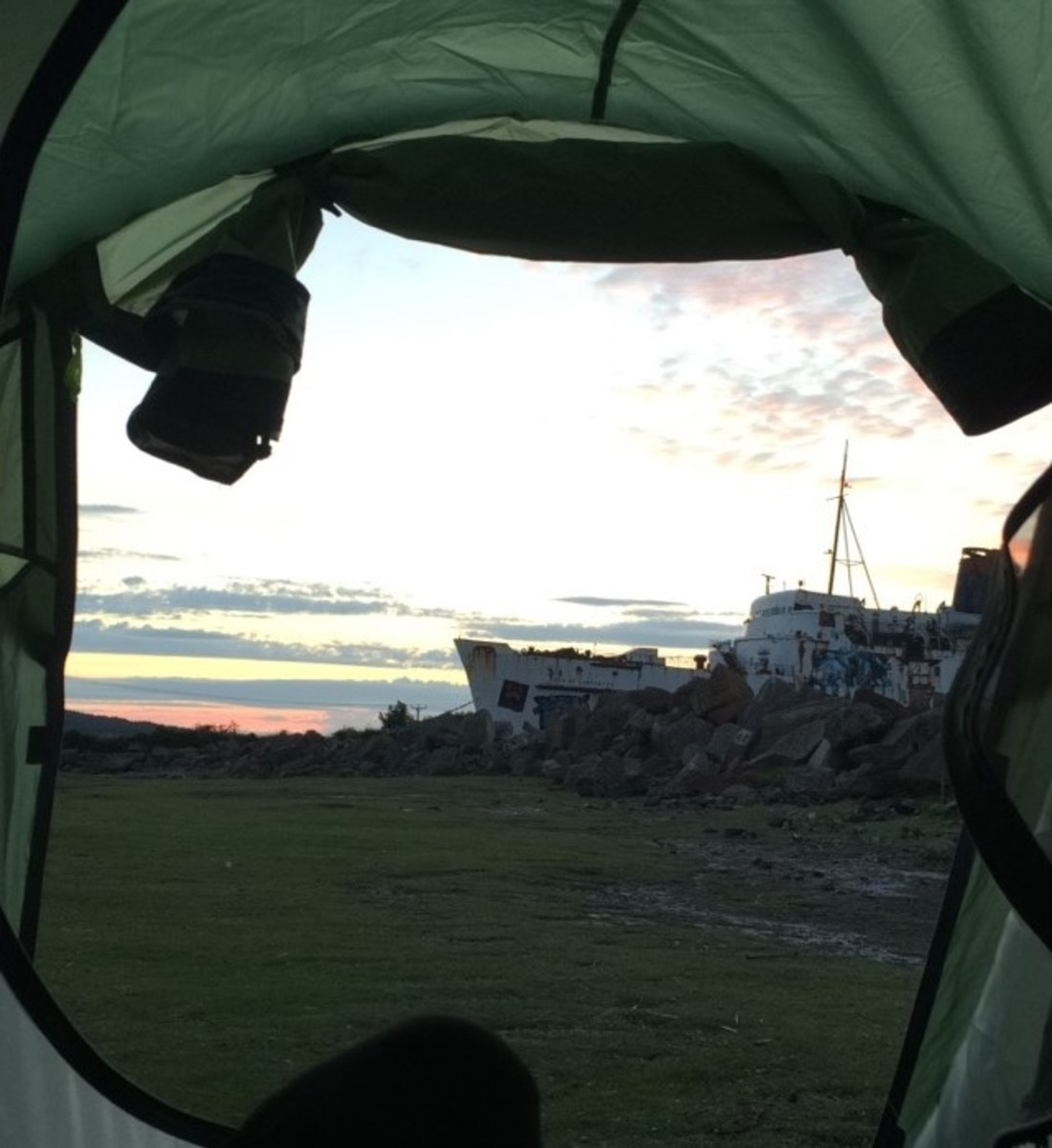 Waking up whilst wild camping next to the TSS Duke of Lancaster ship near Mostyn, North Wales Coast Path