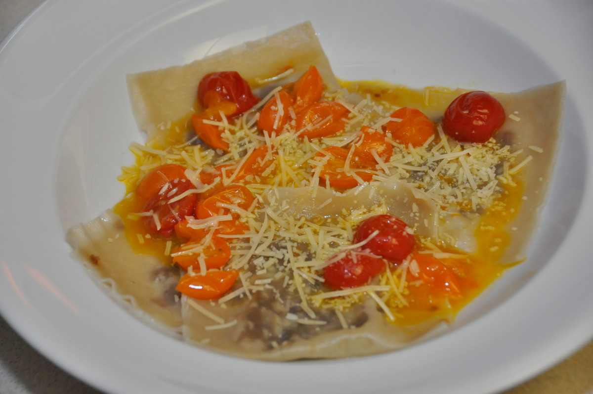 Wonton ravioli with seared red and yellow cherry tomatoes, which are a great source of lycopene