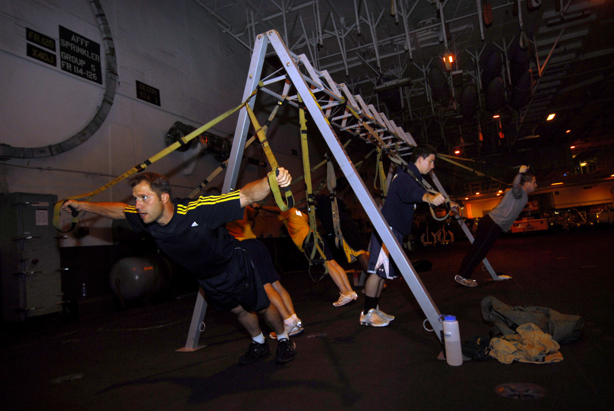 TRX standing chest flye.