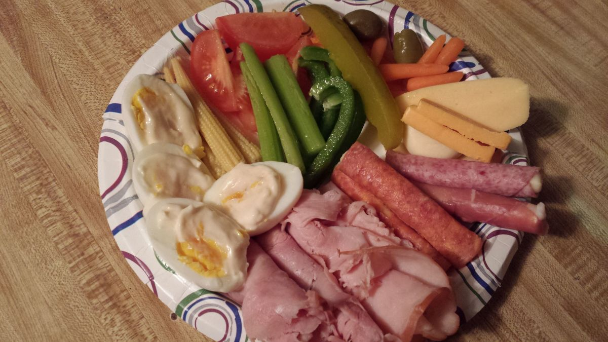 Celery sticks, Hard boiled egg, pickle, cheese, variety of cold cuts ie: chicken, ham, turkey, salami, carrots