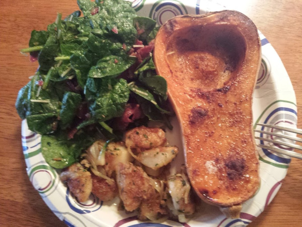 Baked Butternut Squash with a teaspoon butter and sprinkled with cinnamon, sauteed scallops, spinach salad with bacon.