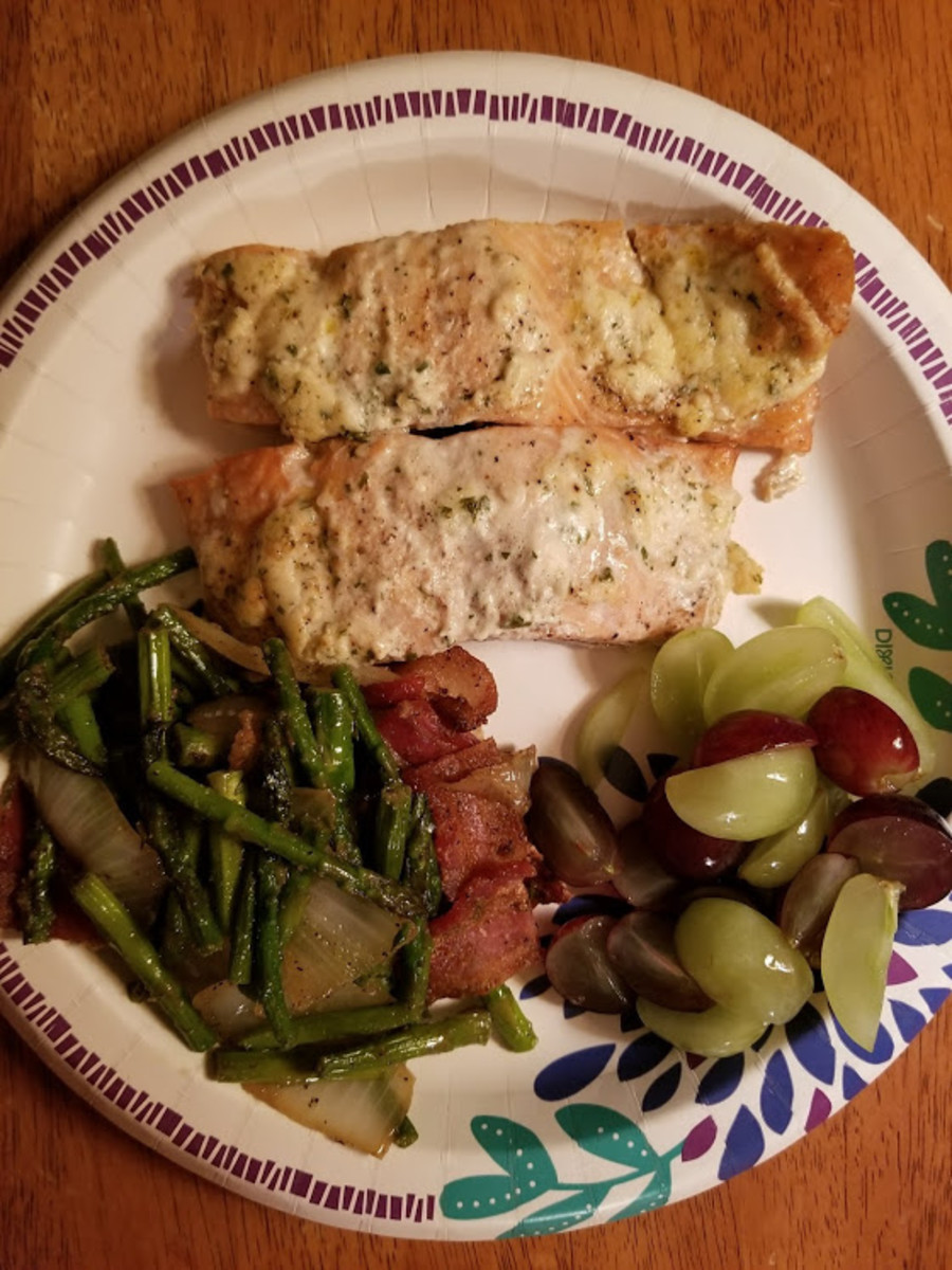 Baked Salmon topped with Alloette Smear Cheese, Asperagas with Bacon and oninons, sliced grapes.