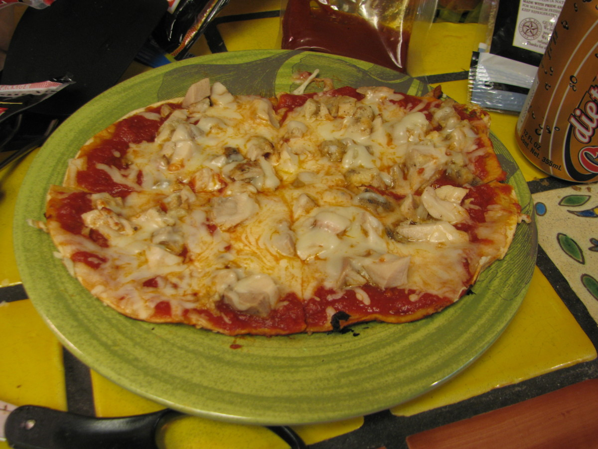 Chicken Skillet Pizza.  Use sauce, chopped chicken and fat free cheese.