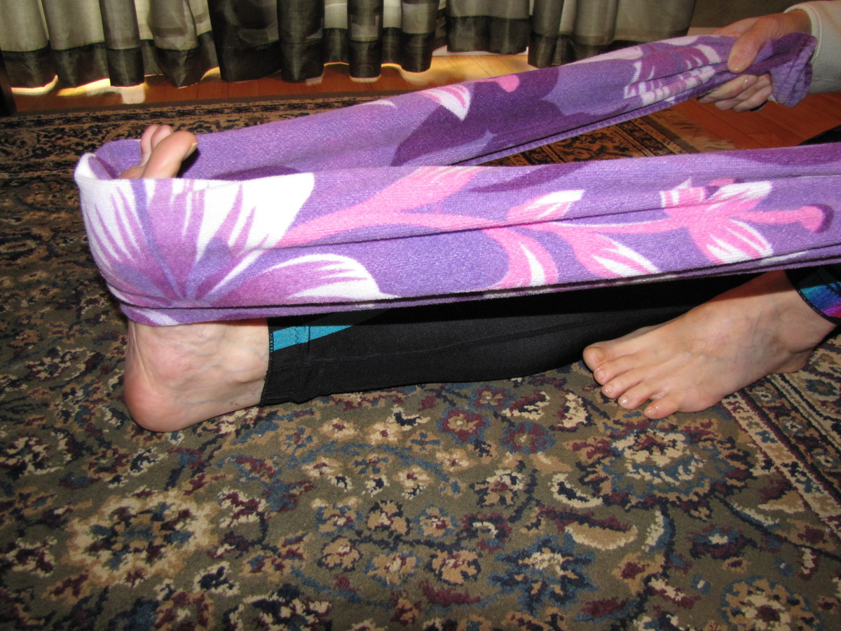 Use a towel to pull the top of the foot toward you