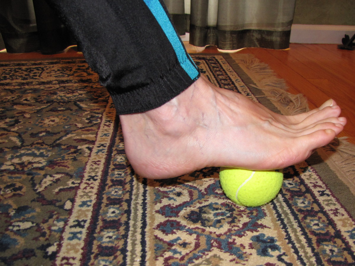 Roll your foot over a tennis ball or can