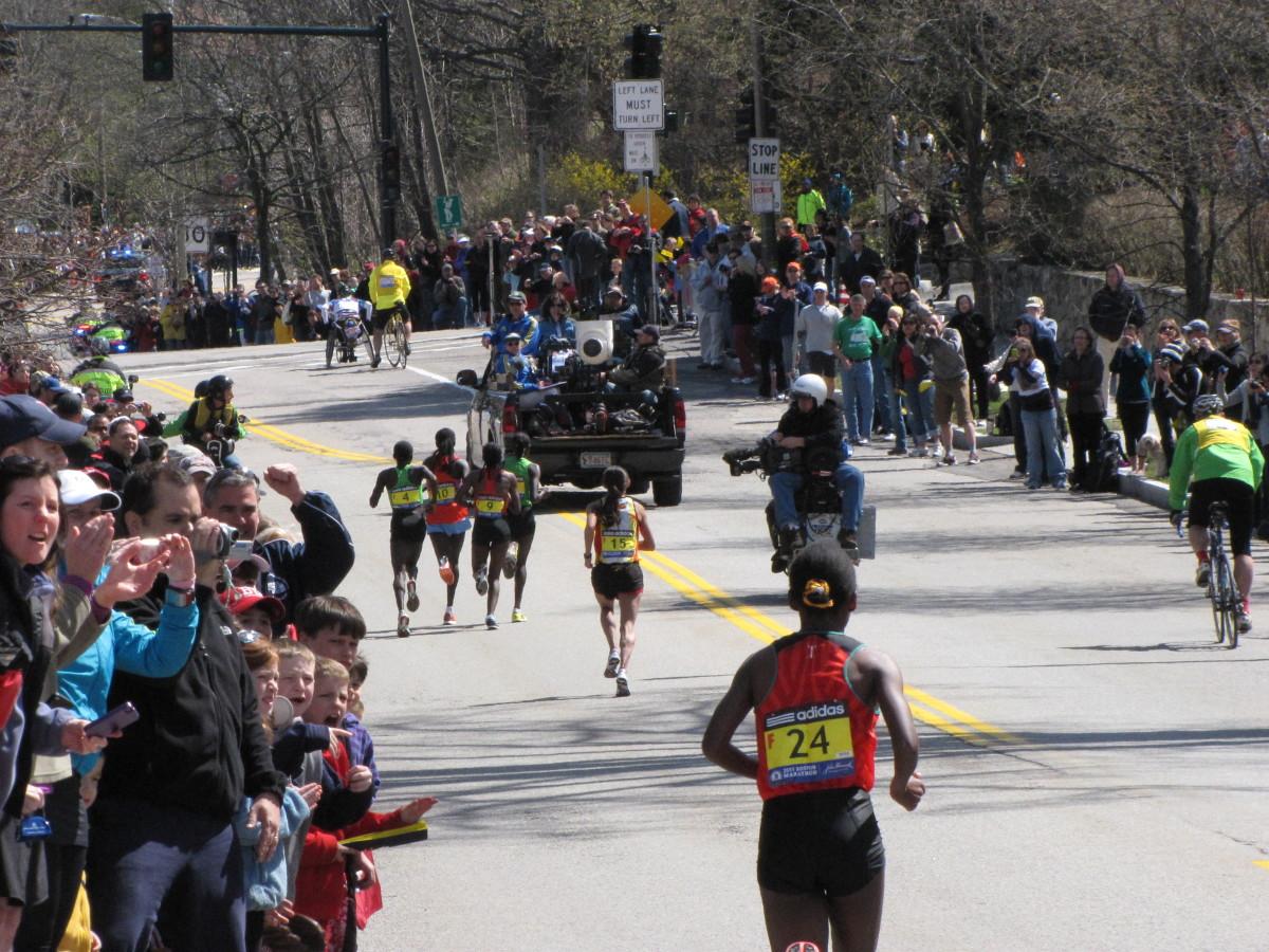 The lead group of women runners heading up heartbreak hill.
